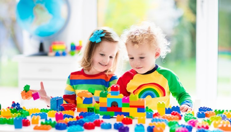 Kids playing with colorful blocks at daycare