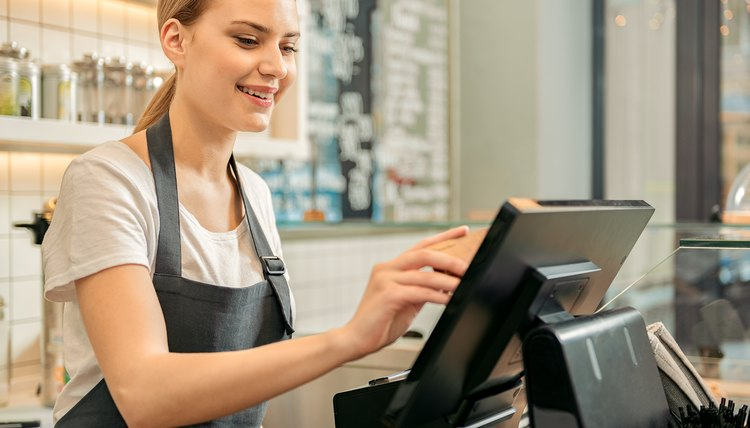 Shop assistant using digital device for payment