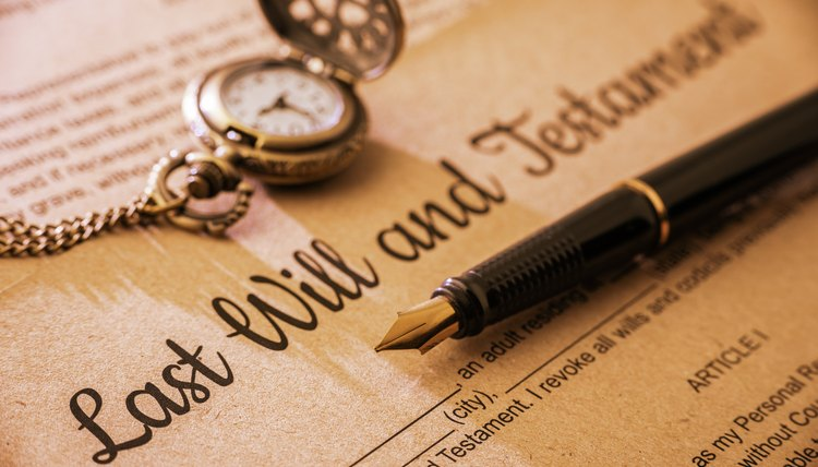 Fountain pen, pocket watch on a last will and testament.