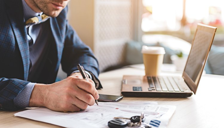 Man working writing a letter at desk