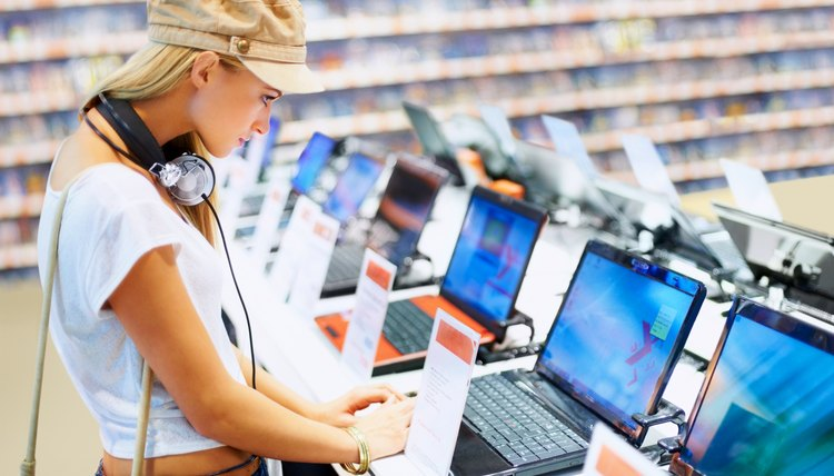 Woman shopping in retail computer store