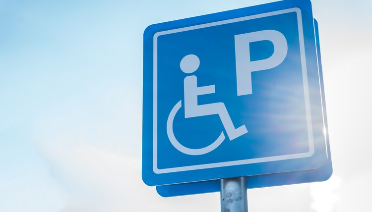 Blue handicapped parking symbol in car park
