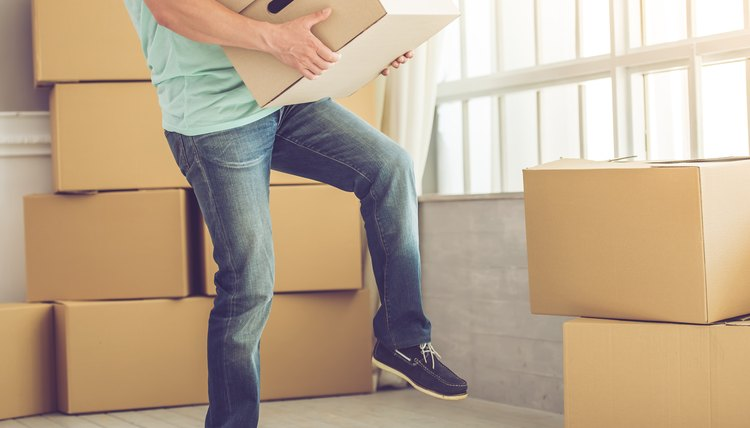 Man carrying moving boxes, moving out