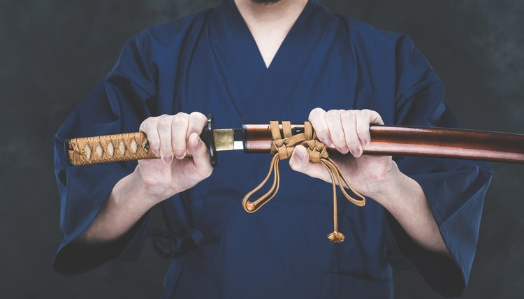 Man holding Japanese Samurai sword