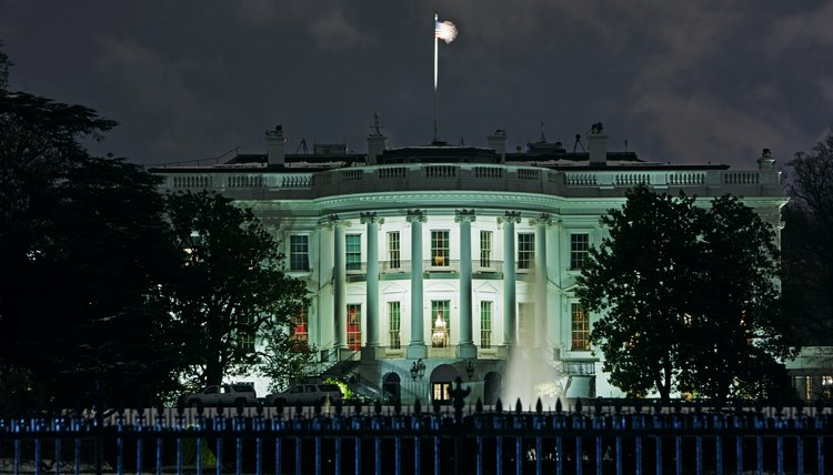 Facade of the White House illuminated at night