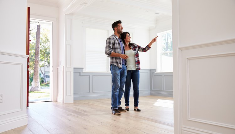 Couple looking at their new home