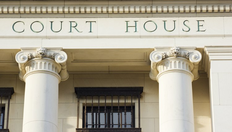 Courthouse Sign and Architectural Columns of Legal System Building Exterior