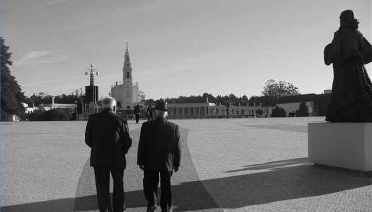 Men walking toward Fatima Cathedral