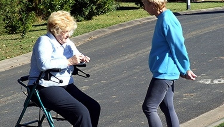 A woman rests after using her walker.
