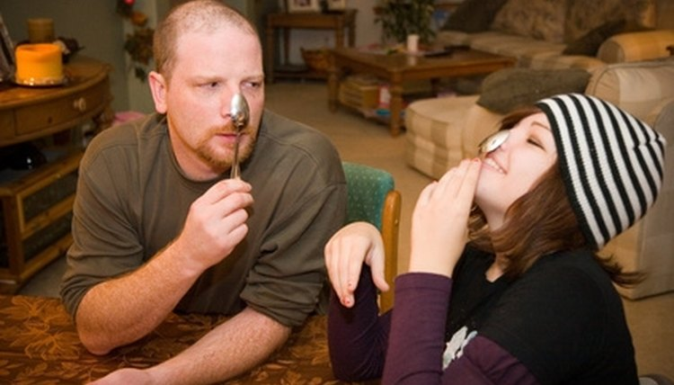 Example: The spoon balanced on her uncle's nose.
