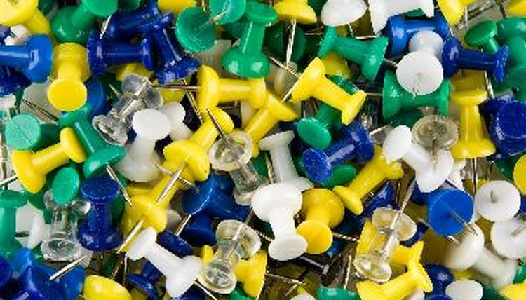 Plastic Push Pins Abstract Business Background
