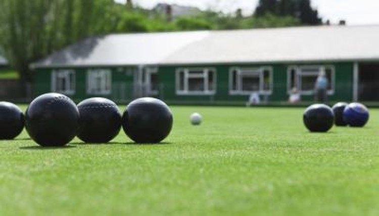 Bowling balls on grass.