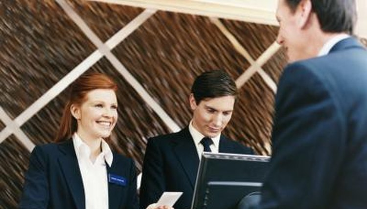 Woman working at hotel front desk
