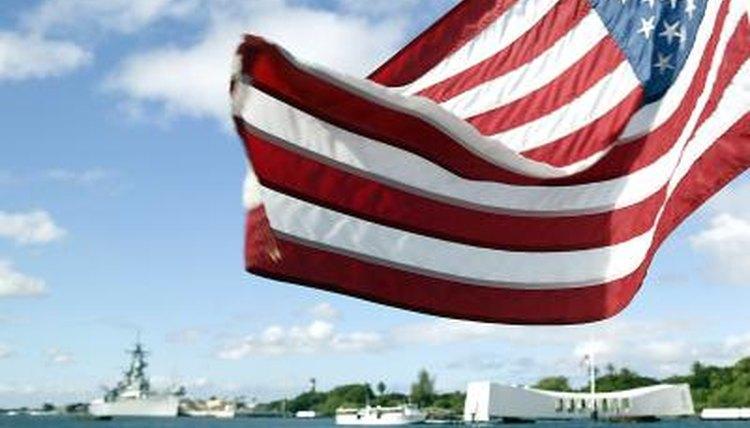 USS Arizona memorial looms in background below U.S. Flag