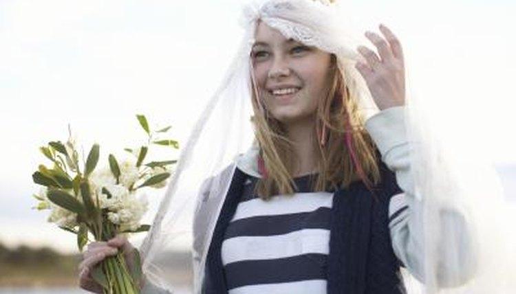 Teenage girl in bridal veil