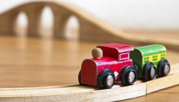 A toy wood train set and tracks.
