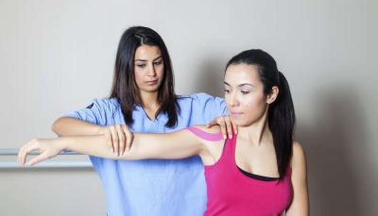 A physical therapist is working with her patient.