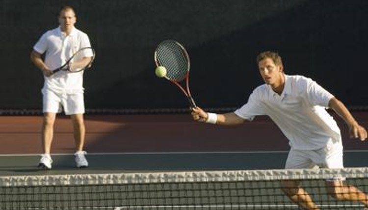 Two tennis players on the court.