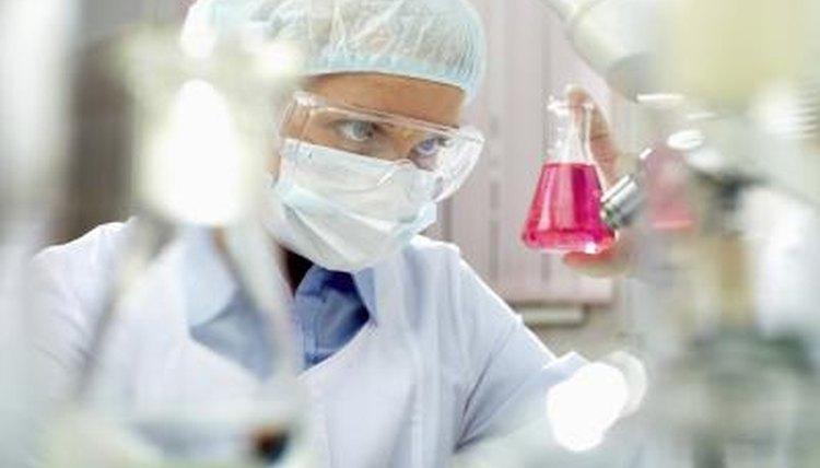 Scientist examining beaker