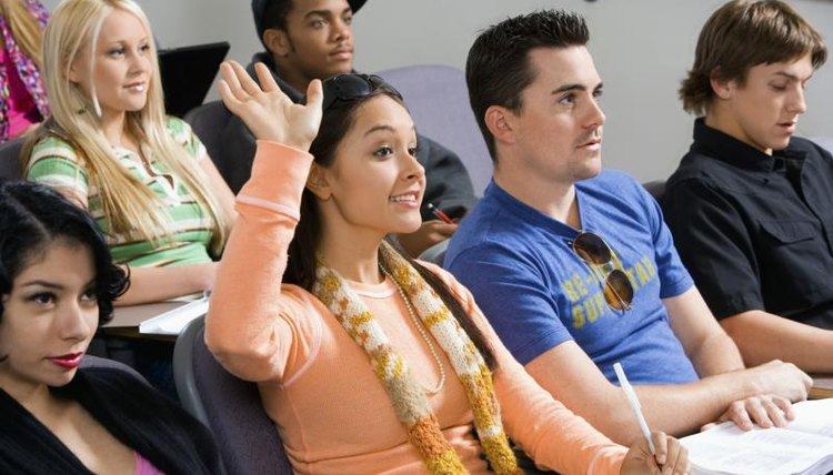 Student raising hand during lecture