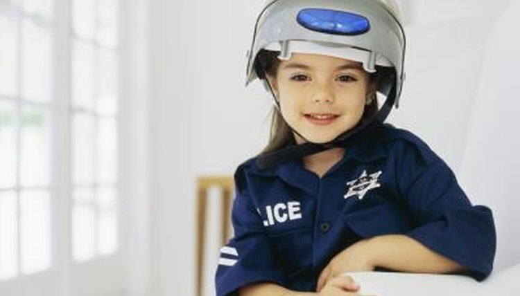 A young girl dressed up as a police officer.