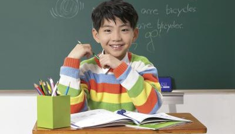 child with personalized pencils