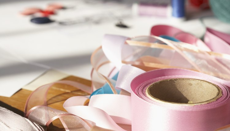 Turn ribbon into a pretty bow to adorn Greek christening candles.