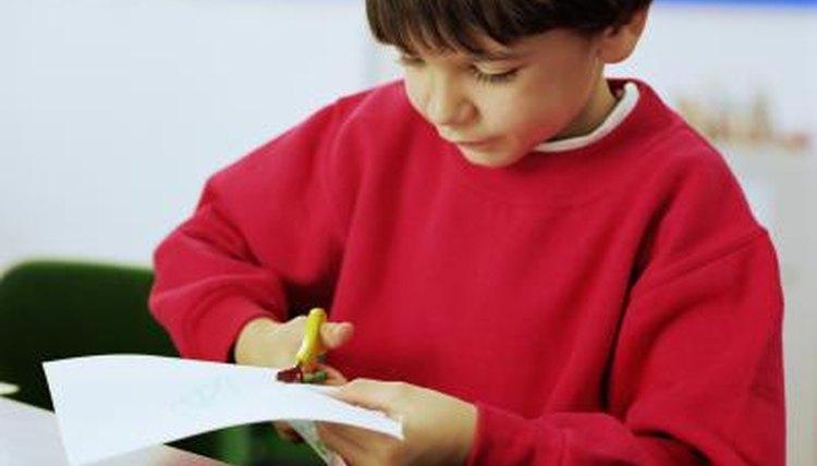 Boy cutting paper