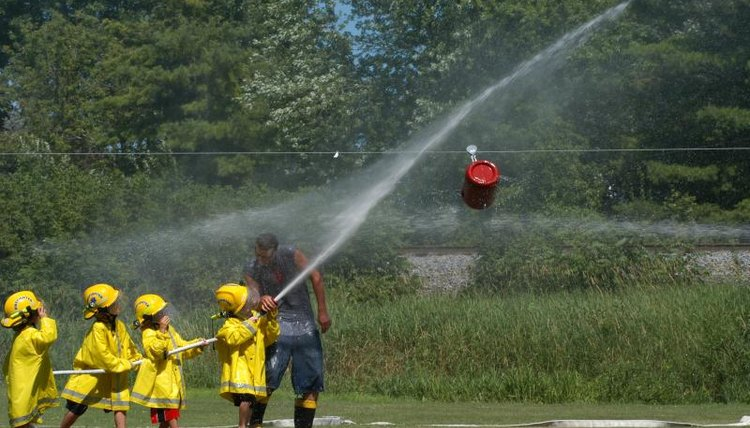 Young children are learning how to be firefighters.