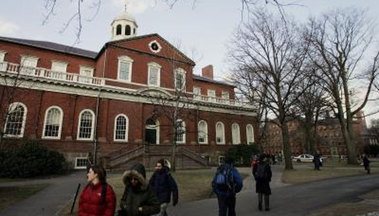 Students walking in front of a building on the Harvard University campus