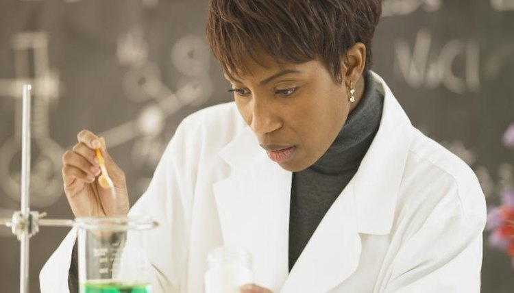 Biochemist working in laboratory.