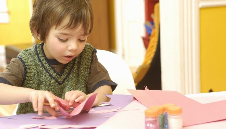 Boy playing with crafts
