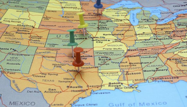 Map of the different states in the U.S. with push pins.