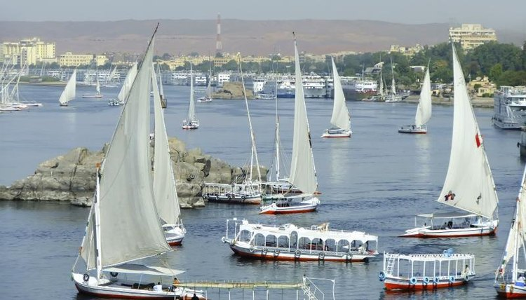 Boats transporting people across the Nile.