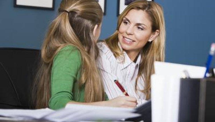 Mother talking to daughter in office