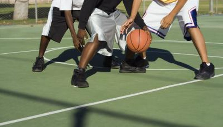 Students playing on outdoor basketball court