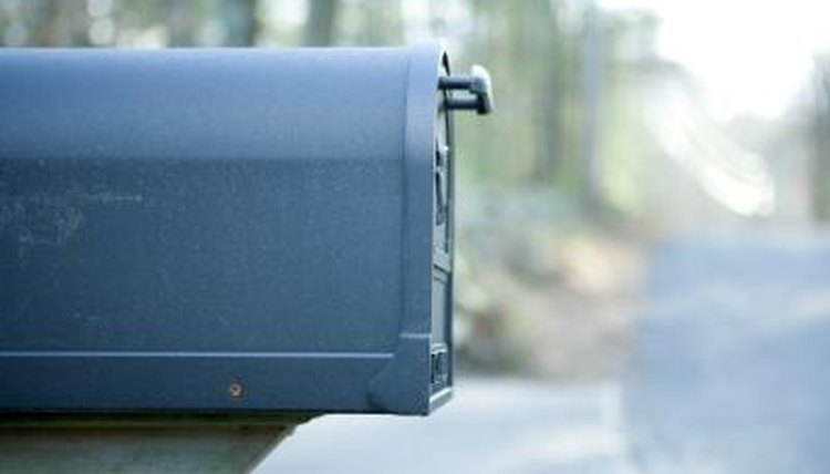 Side view of a mailbox on the street.