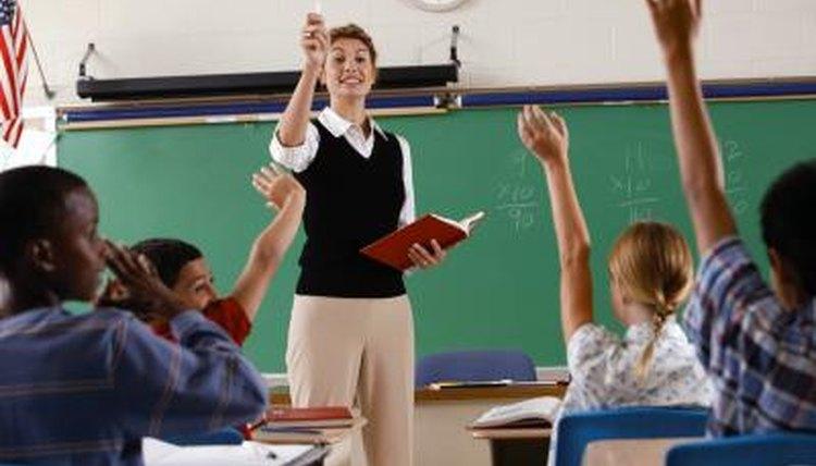 Students raising hands in classroom.