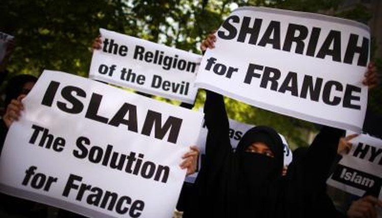 Demonstrators protest over a ban on women covering their faces in France.