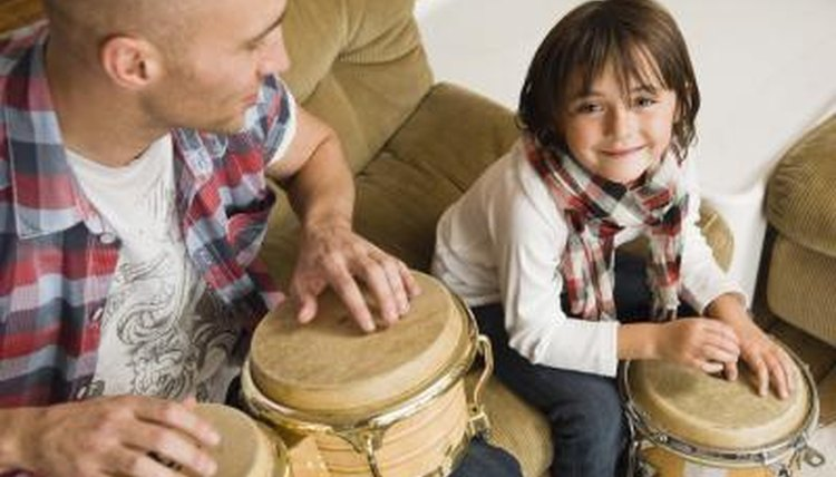 The teacher uses a drum to create a rhythm and asks children to make their feet do what the drum does.