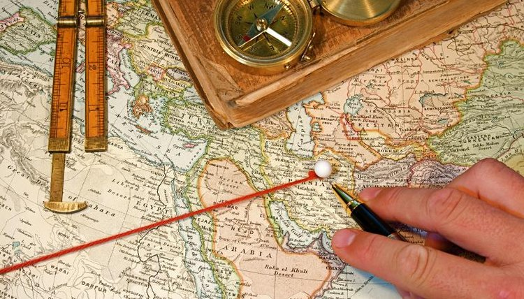 A map with yarn used for comparing distances.