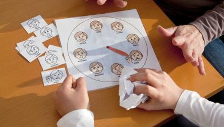 A teacher uses a chart to help a child work through emotions.