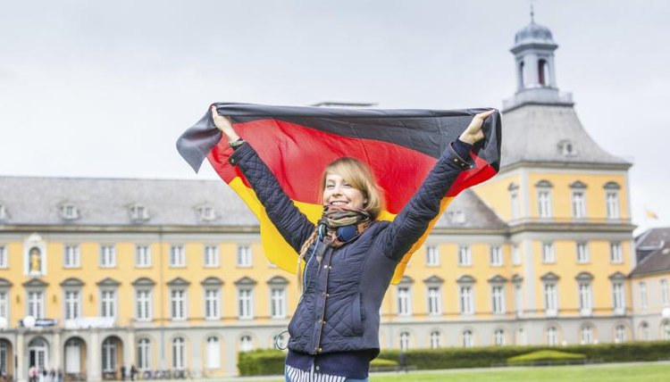 Girl with a German flag in front of Bonn University.