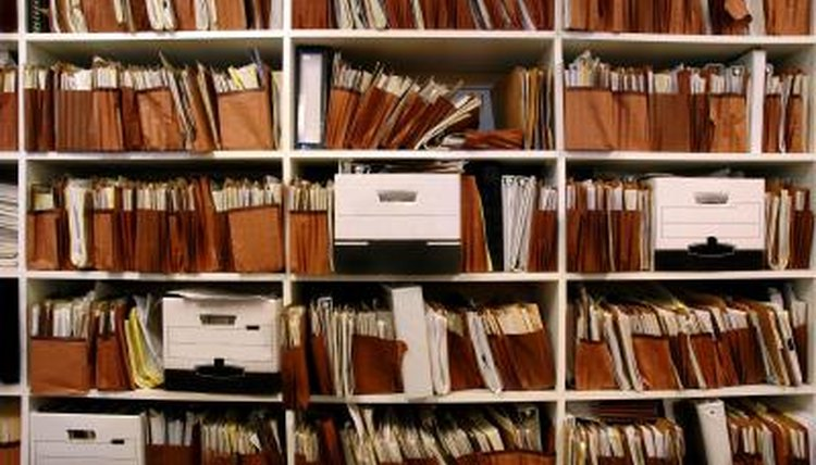 Business documents archived on shelves.