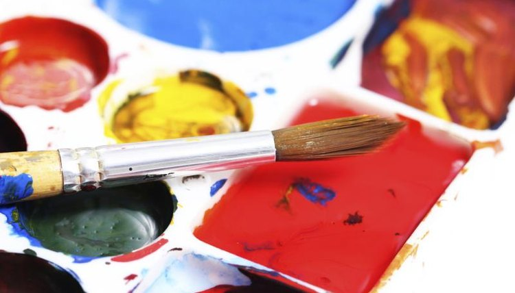 Close-up of paintbrush and watercolors