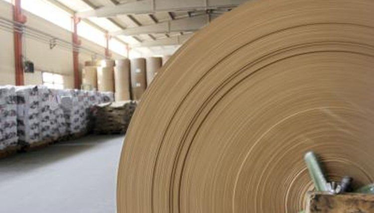 A large spool of paper is produced from recycled material in a factorty