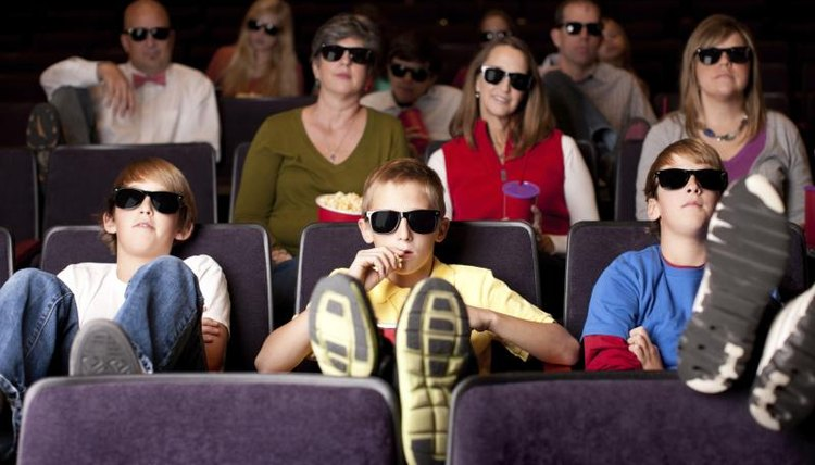 Teenagers watching a movie.