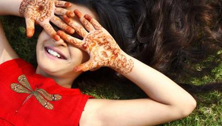 Long ago, the henna plant's stem and leaves were ground up and made into a paste as a paint for the skin.