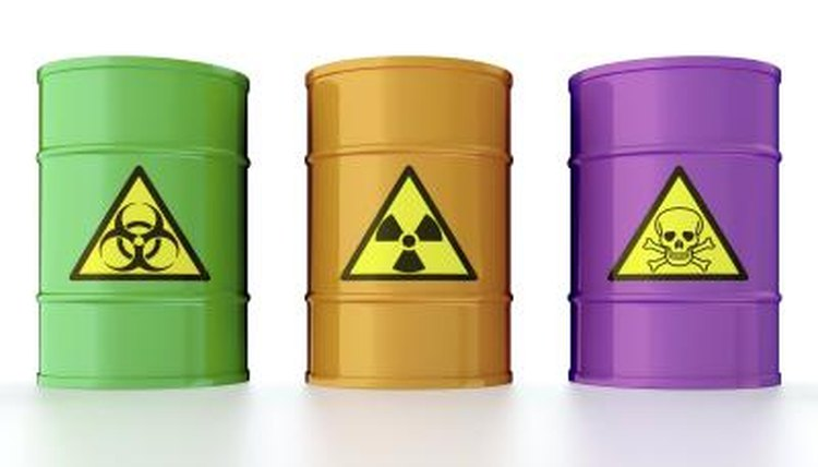 Green, orange, and purple containers with radioactive materials.