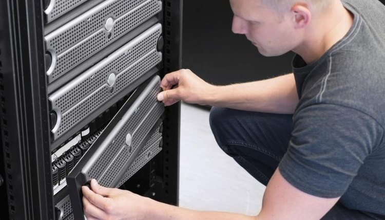 A technician works on a server mainframe.